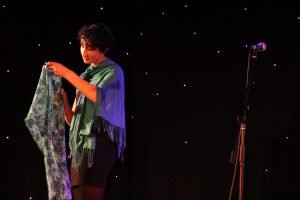 Gabriela Georges performs wearing her mother's scarves, as a way to honour her memory and remain connected.